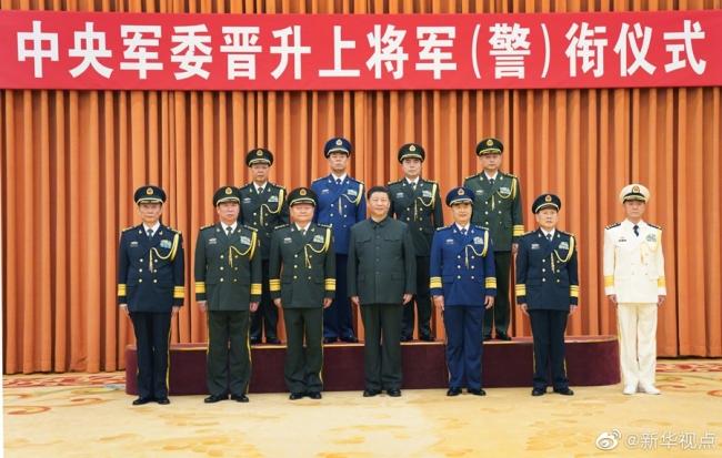 中央军委举行晋升上将军衔警衔仪式,习近平颁发命令状并向晋衔的军官警官表示祝贺