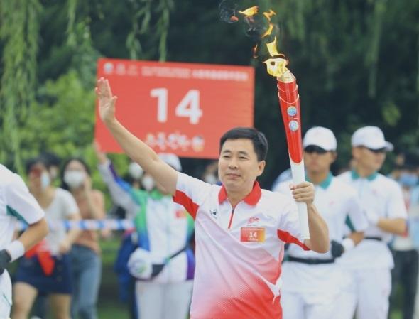 刘五鹏:接力全运火炬 展示统战风采